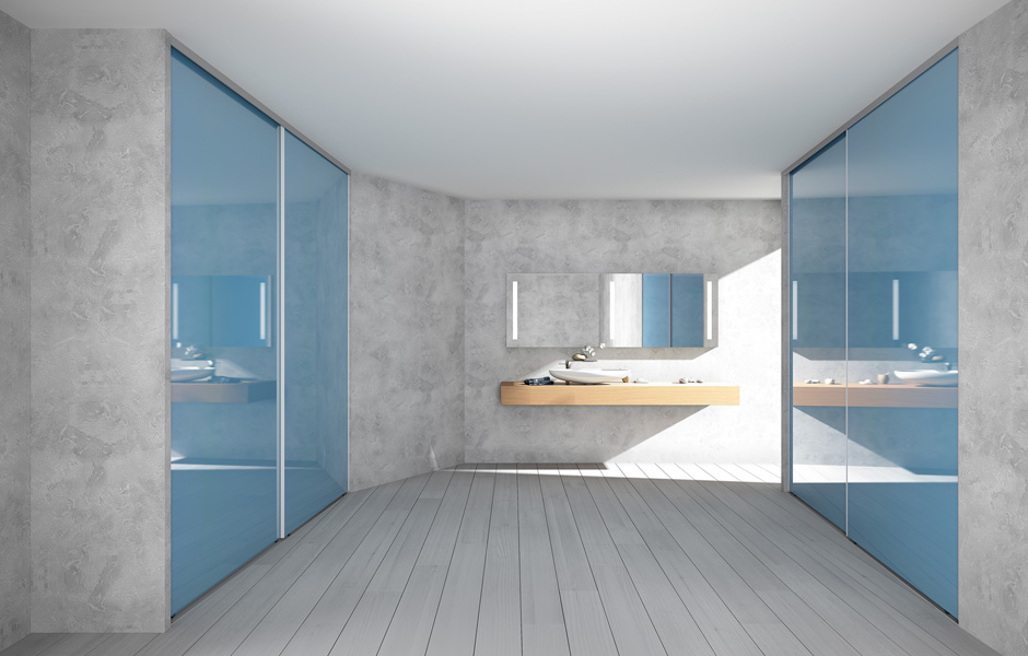 A bathroom created with wall units that enclose 2 sliding doors in glass with lacquer to sample and a large side handle in aluminium – your eyes are also drawn to the slanting of the wall, created upon request from the project's designer.